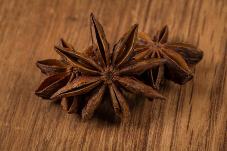 star of anise on rustic wood background photo