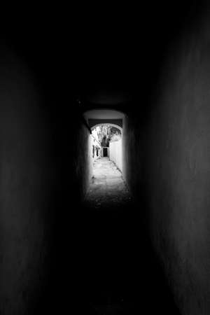 Black and white tunnel in the old town of Lisbon, Portugal photo