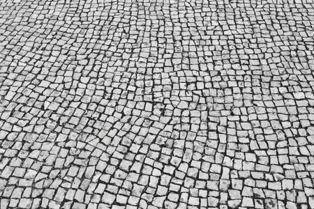 Background texture of typical portuguese walkway pavement photo
