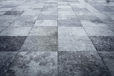 ground floor: Granite square texture background with dark edges
