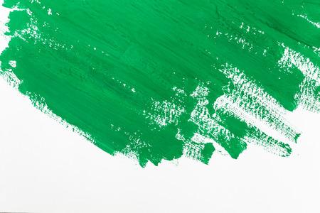 child drawing: abstract green paint brush strokes watercolor background on white paper