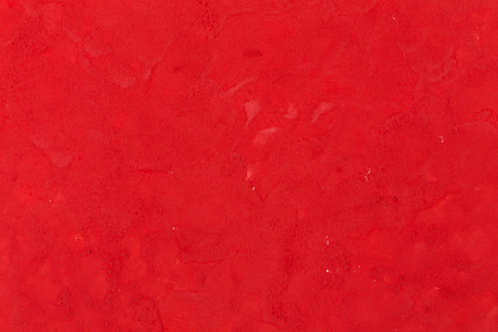 Red paint put on a white paper