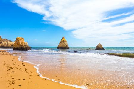 Rocky cliffs on the coast of the Atlantic ocean in Lagos, Algarve, Portugal