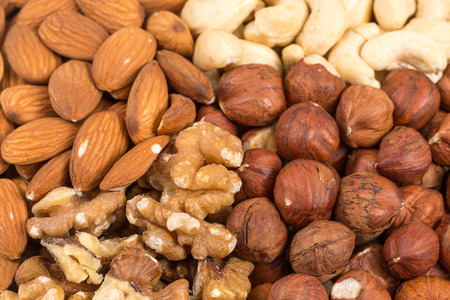 Set of various nuts in bowl as a background photo
