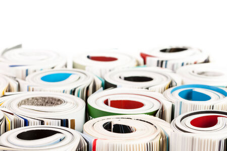 Stack of color magazines on white background photo