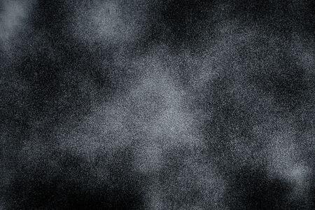 bright center: Black texture background with bright center spotlight
