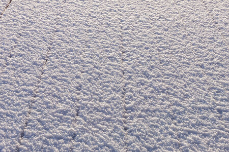 Snow-covered wood terrace floor background