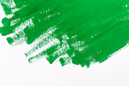 abstract green paint brush strokes watercolor background on white paper photo