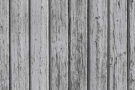 decoratively: Wooden wall with white paint is severely weathered and peeling