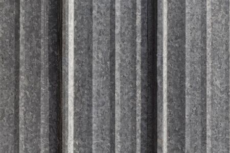 corrugated steel: Dirty metal fence as a background texture Stock Photo