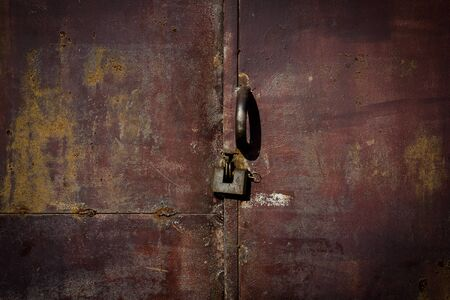 Close up of lock and old metal door photo