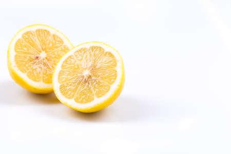 sappy: Two lemon slices on a white background Stock Photo