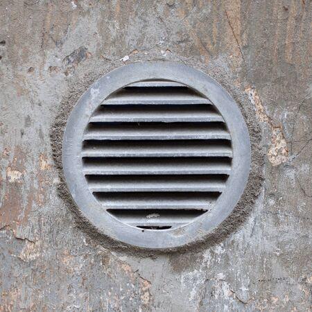 ventilation: metal ventilation window on wall background