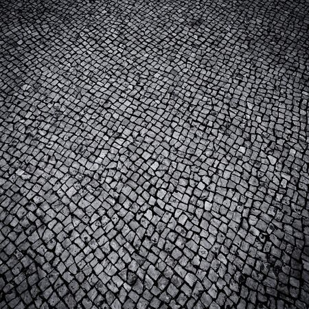Background texture of a walkway small stone pavement photo