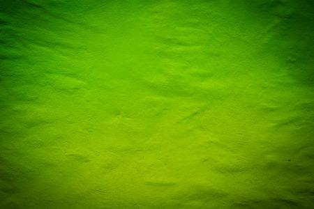 dark texture: Fondo verde oscuro de textura brillante con reflector central
