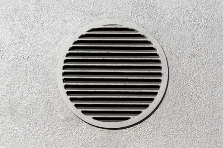 ventilate: Circle vent window on metallic concrete wall Stock Photo