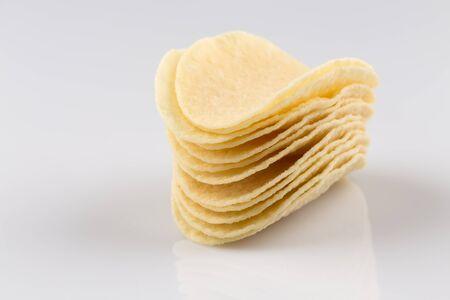 prepared potato: Prepared potato chips snack closeup view on white background