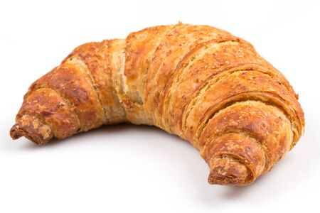 Fresh and tasty croissant over white background photo