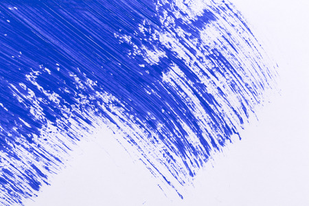 blue stroke of the paint brush on white paper photo