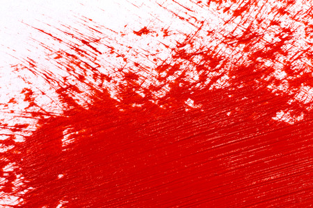 Red stroke of the paint brush on white paper photo