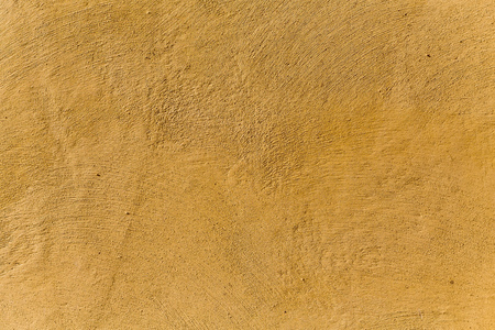 Yellow background made with a texture of a plaster wall photo