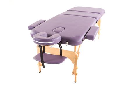 白い背景の下でのマッサージ ベッド テーブル