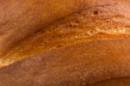 long loaf: Fragment of long loaf white bread. Whole background. Close up