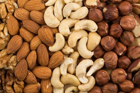 whole pecans: Peanuts, walnuts, almonds, hazelnuts, brazil and cashews nuts mixed together