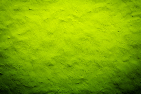 bright center: Greenwith yellow lime texture background with bright center spotlight