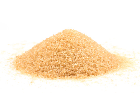 Crystals cane brown sugar isolated on white background