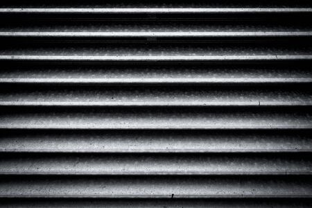 old barn: Dirty dark metal fence - background texture Stock Photo