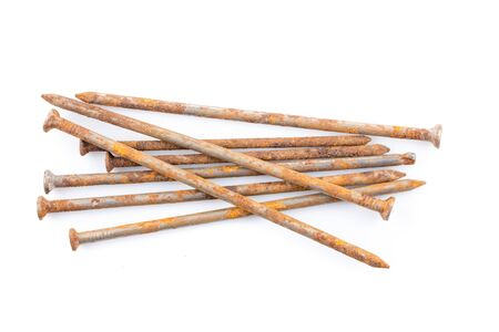 loosen: some old rusty nails on white table