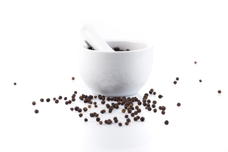 peper: Black peper peppercorns in mortar and pestle Stock Photo