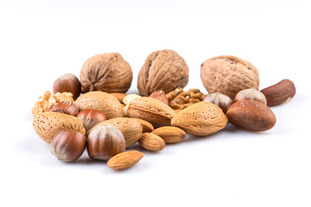 Variety of Mixed Nuts Isolated on White Background Standard-Bild