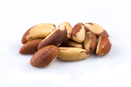 selenium: Brazil Nuts Close-up Isolated on White Background