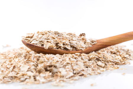 Whole grain, rolled oats flakes with wooden spoon photo
