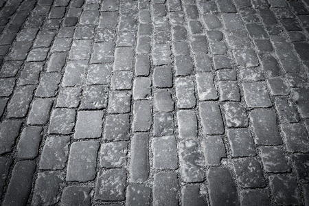 cobblestone road: Old european cobblestone road close up in black and white Stock Photo