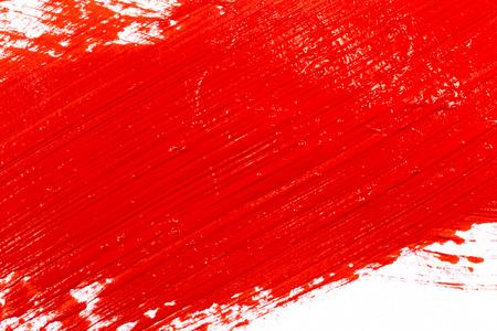 Rode slag van de verfborstel op wit papier Stockfoto