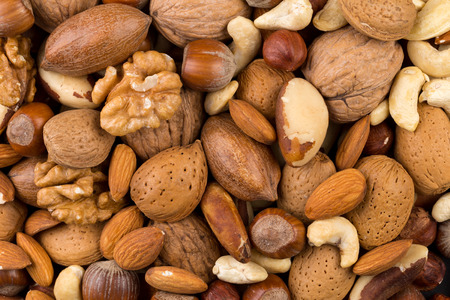 Variety of Mixed Nuts as a background - close up image Banco de Imagens