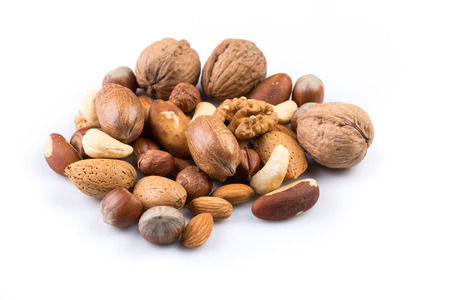 Variety of Mixed Nuts Isolated on White Background Banco de Imagens