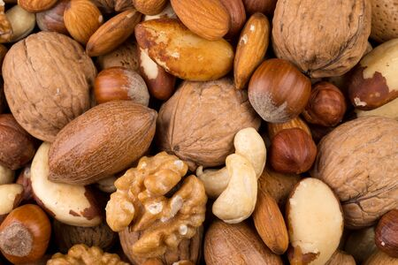 Variety of Mixed Nuts as a background - close up image Imagens