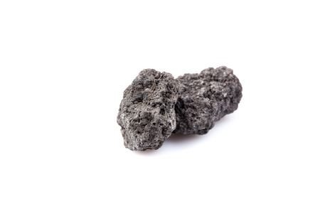 natural force: Black lava rock from volcano on a white background Stock Photo