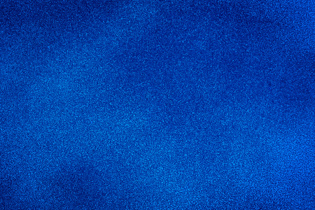 Blue texture background with bright center spotlight Standard-Bild