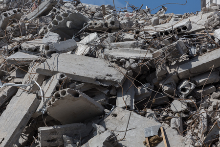 deconstruct: Pieces of Metal and Stone are Crumbling from Demolished Stock Photo