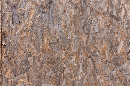 compressed: Old plywood recycled compressed wood chippings board background texture Stock Photo