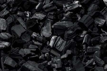 Coal mineral black as a cube stone background