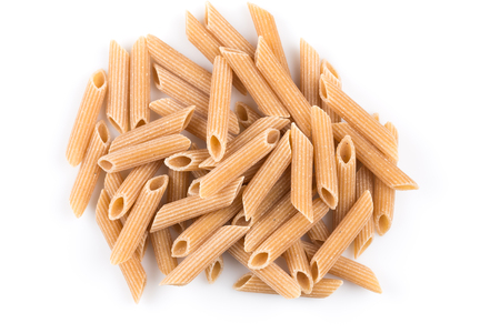 Wholemeal Pasta Penne as close-up shot isolated on white background