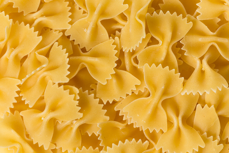 Close up of uncooked farfalle pasta as a background