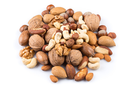 Variety of Mixed Nuts Isolated on White Background Stockfoto