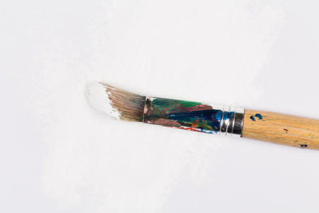 brush in: Used paint brush in white color on white paper